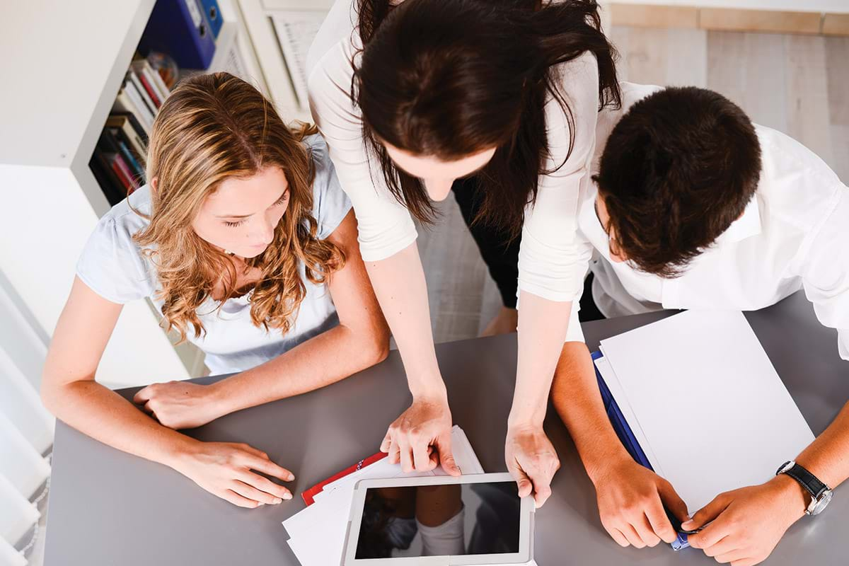 A family looking at a tablet device.