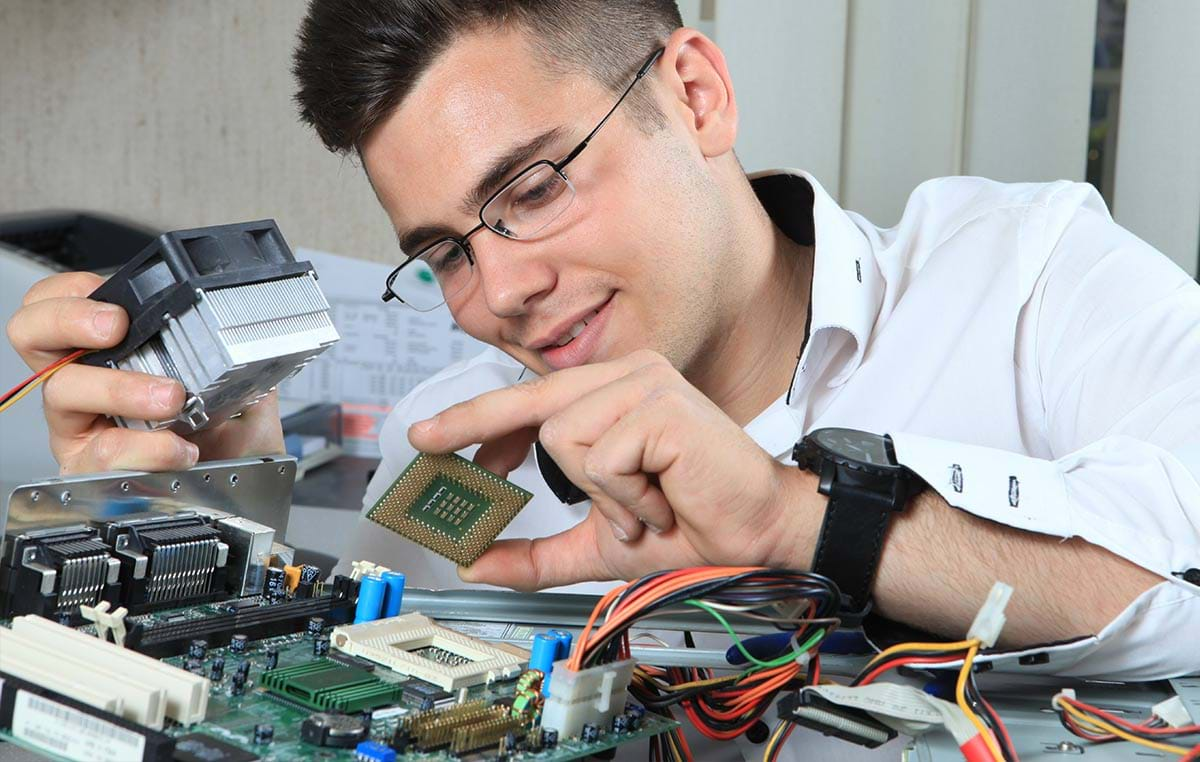 Photograph showing a student working on a microchip board