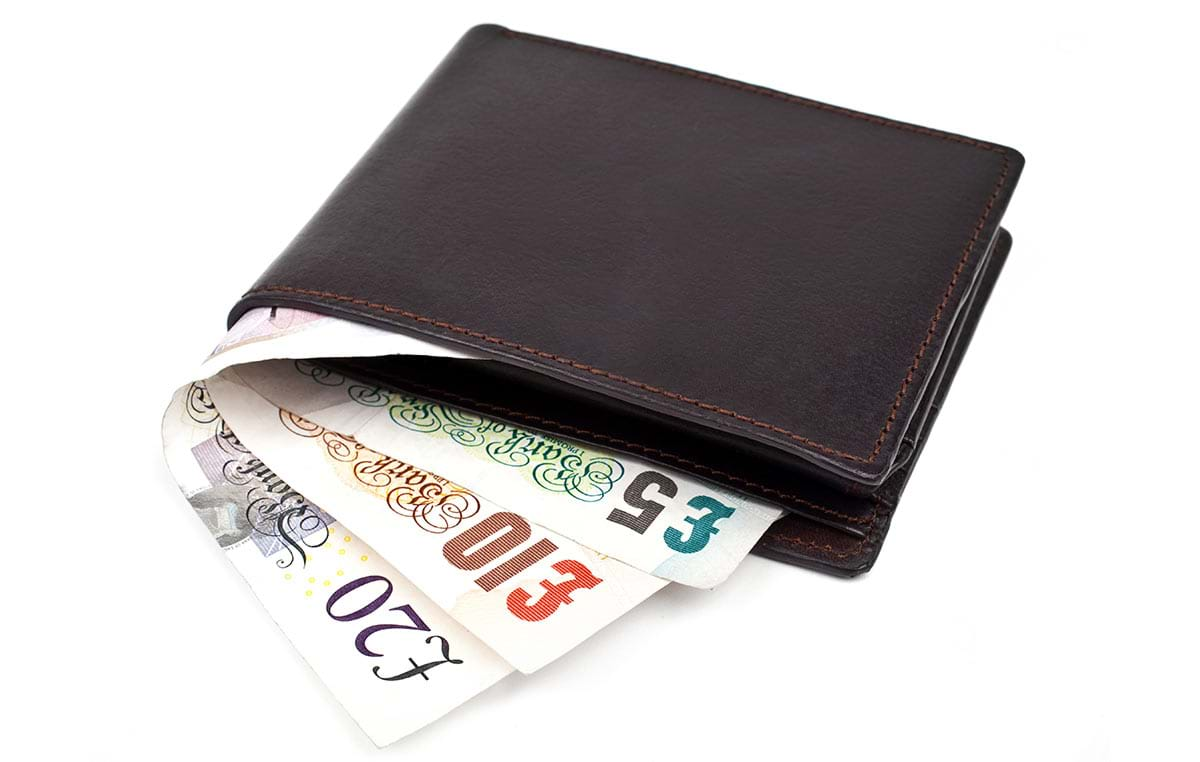 Wallet showing three notes, £20, £10 and £5